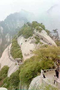 Look at those walkways clinging to the side of the rock.